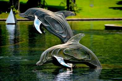 gray and brass metal dolphin pool decor