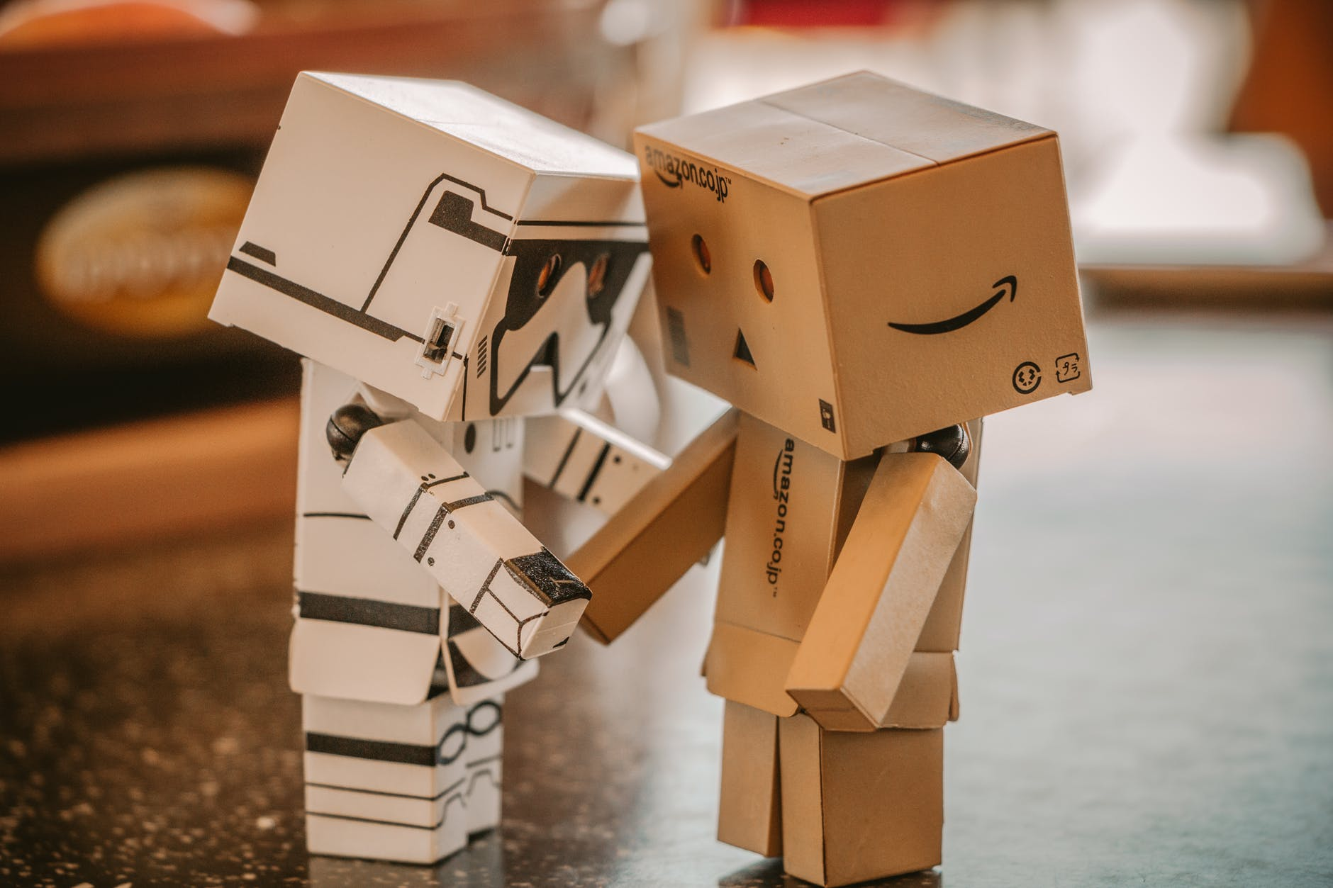 photo of white and brown cardboard box toy figure